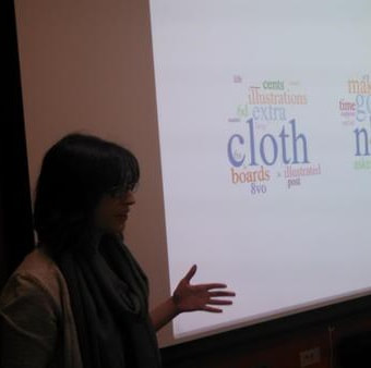 Beth Seltzer in front of topic modeling word clouds